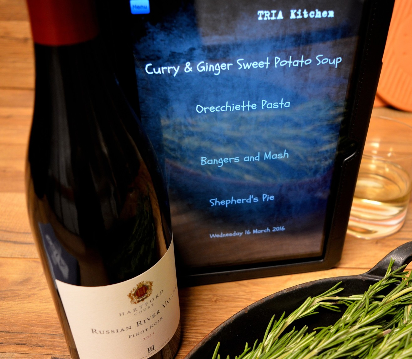 tablet with TRIA's dinner specials