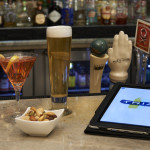 beer, nuts, cocktail, and TRIA tablet menu
