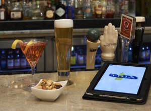 beer, nuts, cocktail, and TRIA tablet menu